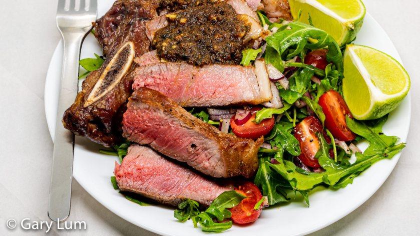 Reverse seared bone-in rib-eye steak with rocket salad