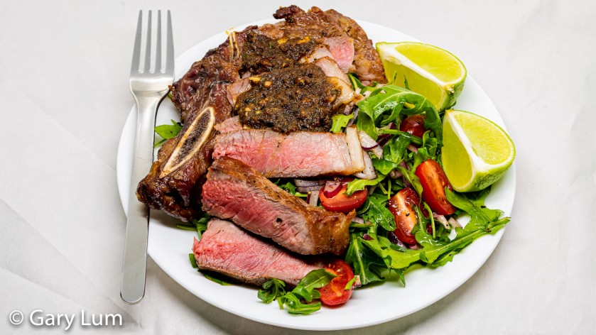 Reverse seared bone-in rib-eye steak with rocket salad
