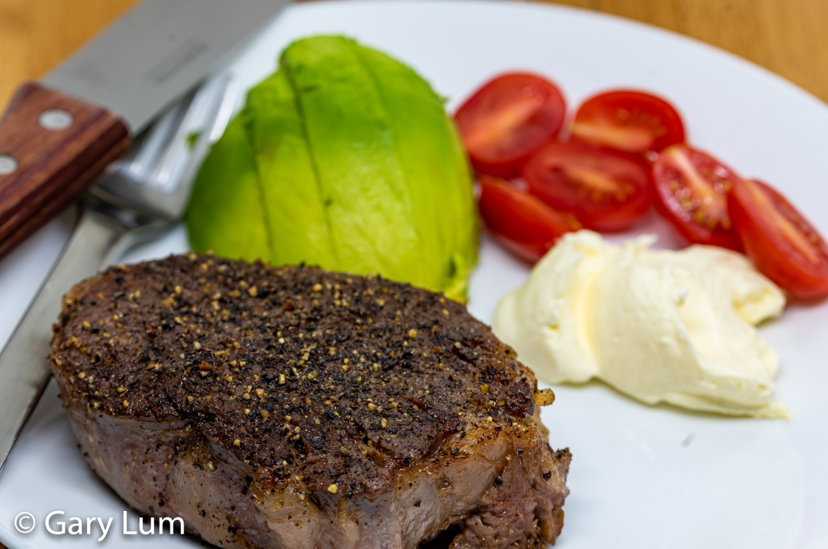 Sous vide scotch fillet steak with avocado, cherry tomatoes, and sour cream