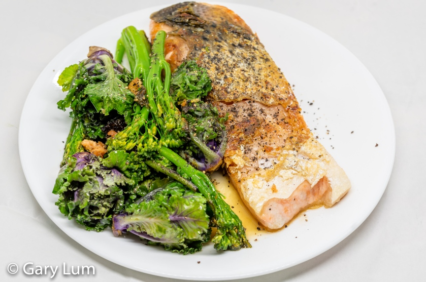 Pan-fried gnarly skinned salmon with steamed broccolini and kale sprouts.
