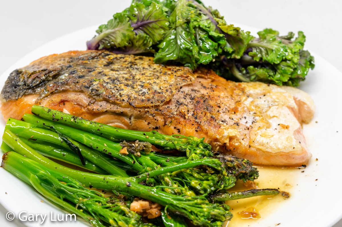 Pan-fried gnarly skinned salmon with steamed broccolini and kale sprouts