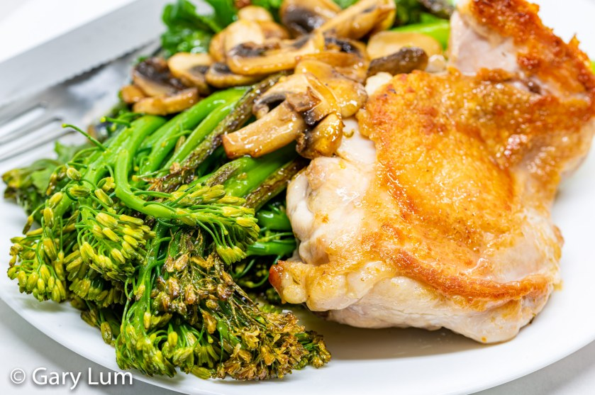 Deboned pan-fried chicken thigh with broccolini and kale sprouts
