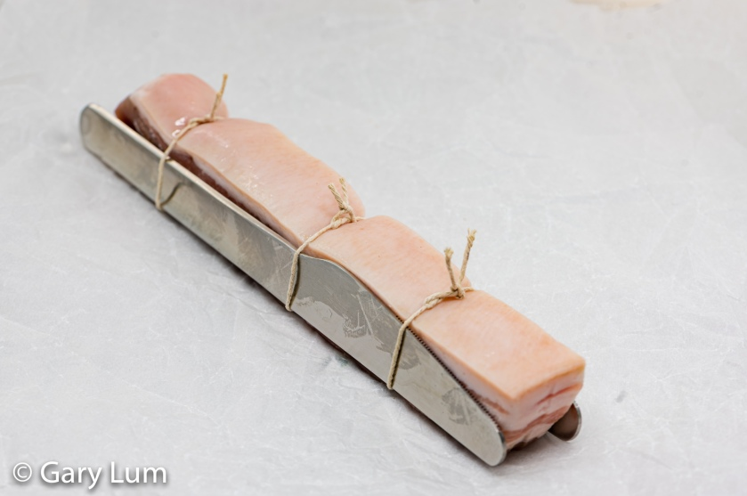 Iron-clad pork belly tied with twine