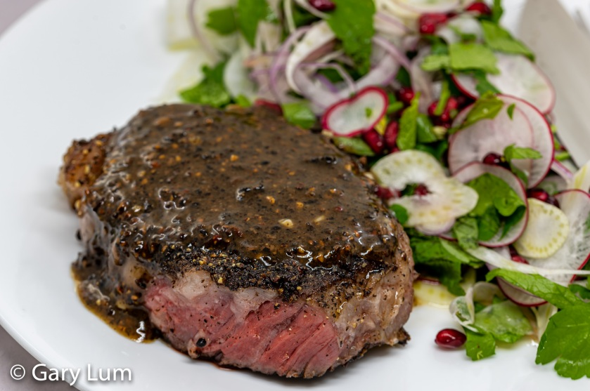 Sous vide pepper steak with fennel and pomegranate salad