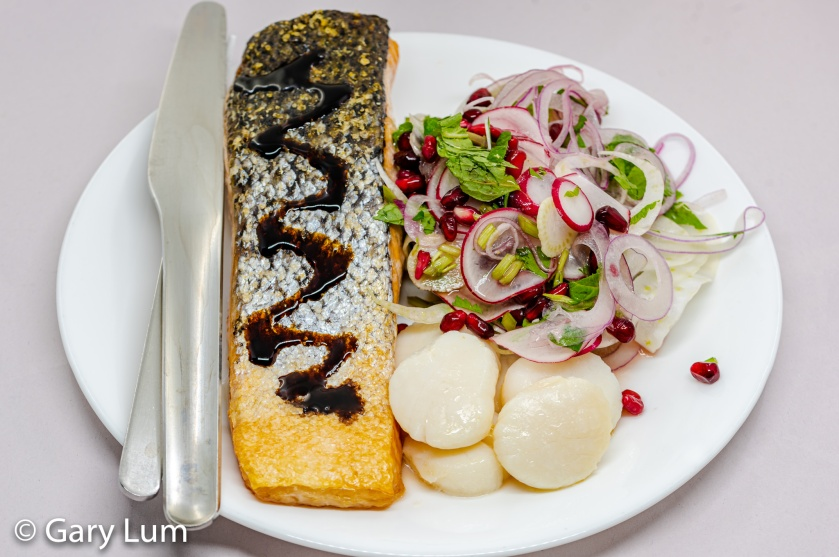 Pan-fried salmon and scallops with fennel and pomegranate salad