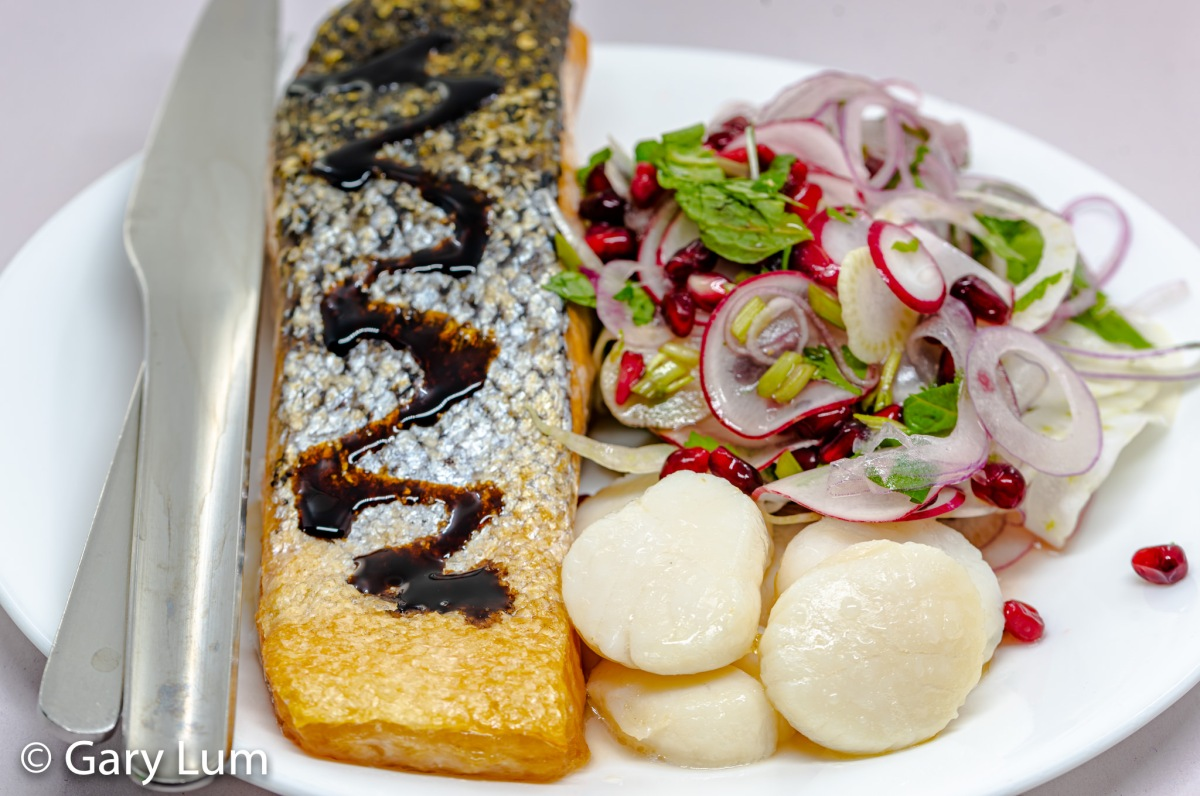 Pan-fried salmon with scallops and fennel and pomegranate salad