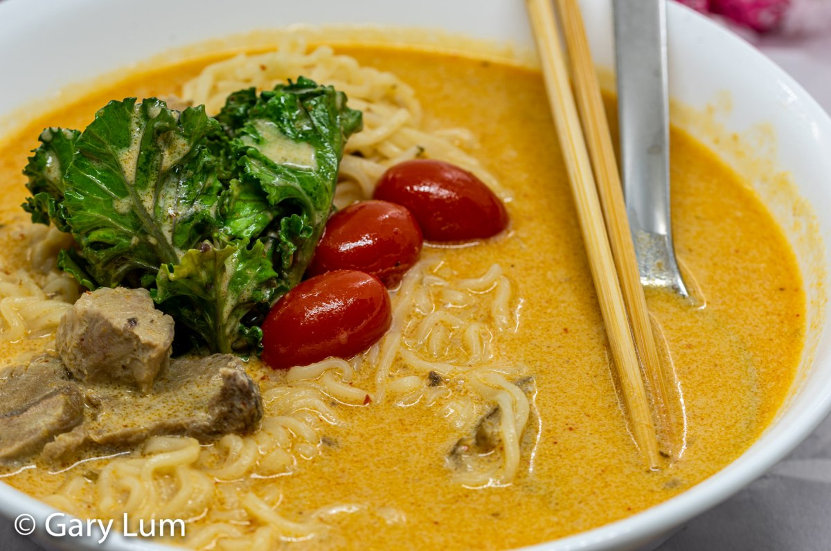 Leftover lamb and noodle Thai red curry with kale sprouts and cherry tomatoes