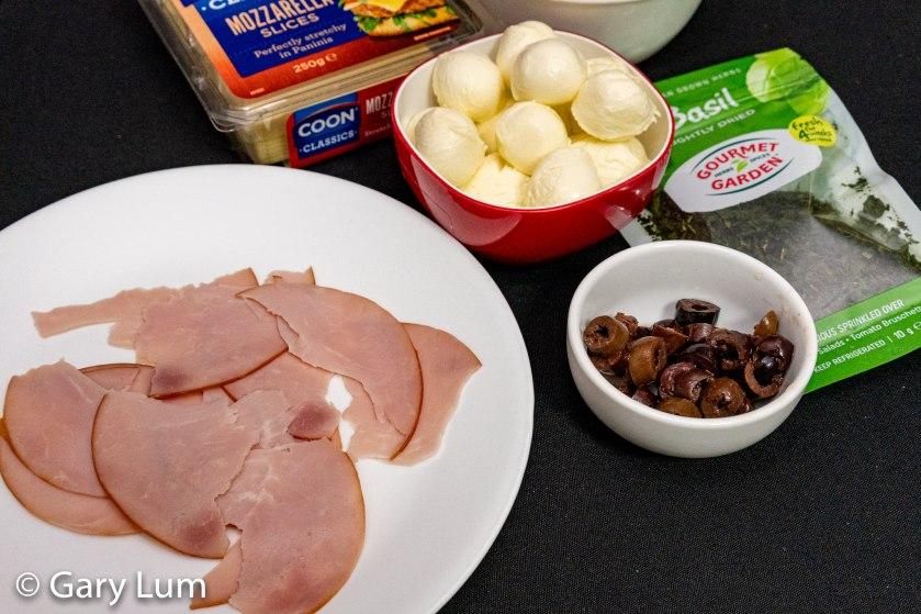 Ham Bocconcini Kalamata olives Mushroom Pizza