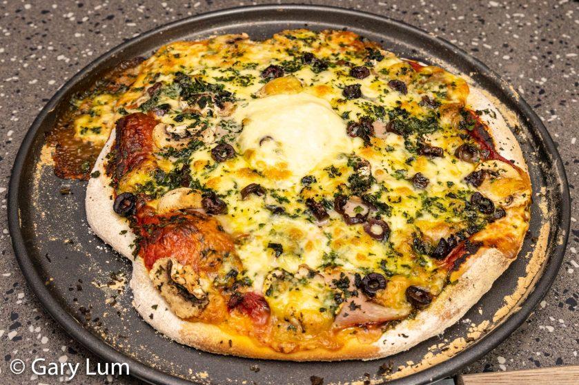 Ham, bocconcini, Kalamata olives, mushroom pizza