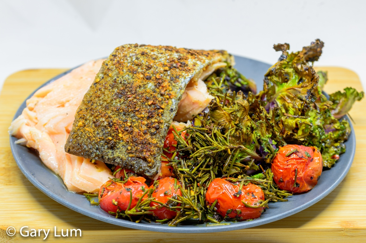 Sous vide salmon with crispy kale sprouts and cherry tomatoes