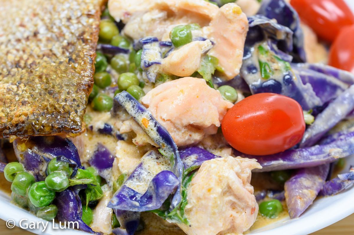 Sous vide salmon with curry coconut cream frozen vegetables