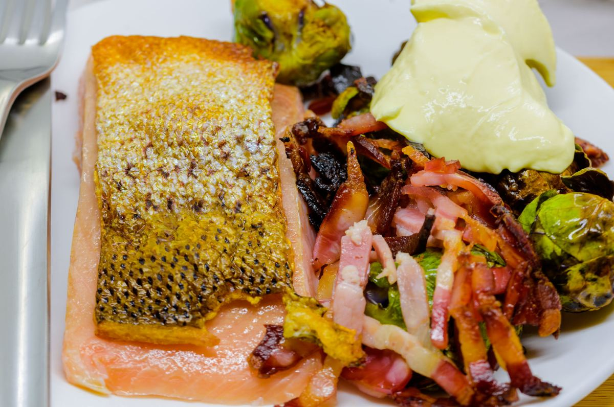 Sous vide salmon with crispy skin plus bacon and Brussels sprouts