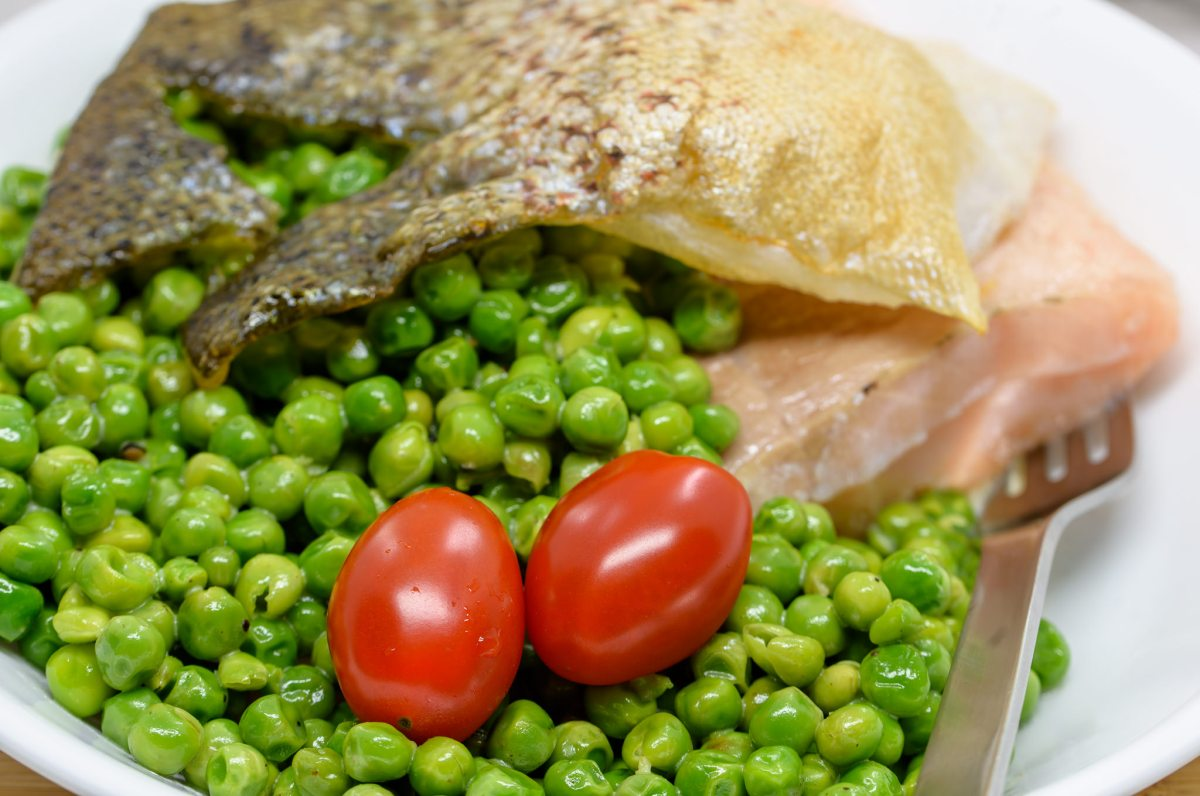 Sous vide salmon with Dijon creamed baby green peas