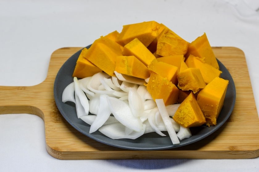Diced pumpkin and sliced white onion
