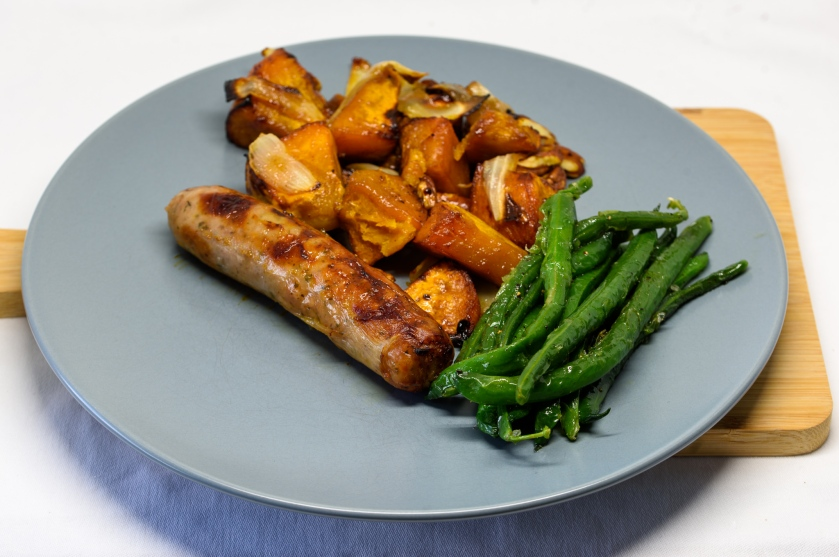 Roast pumpkin and caramelised onion with a pork sausage and green beans