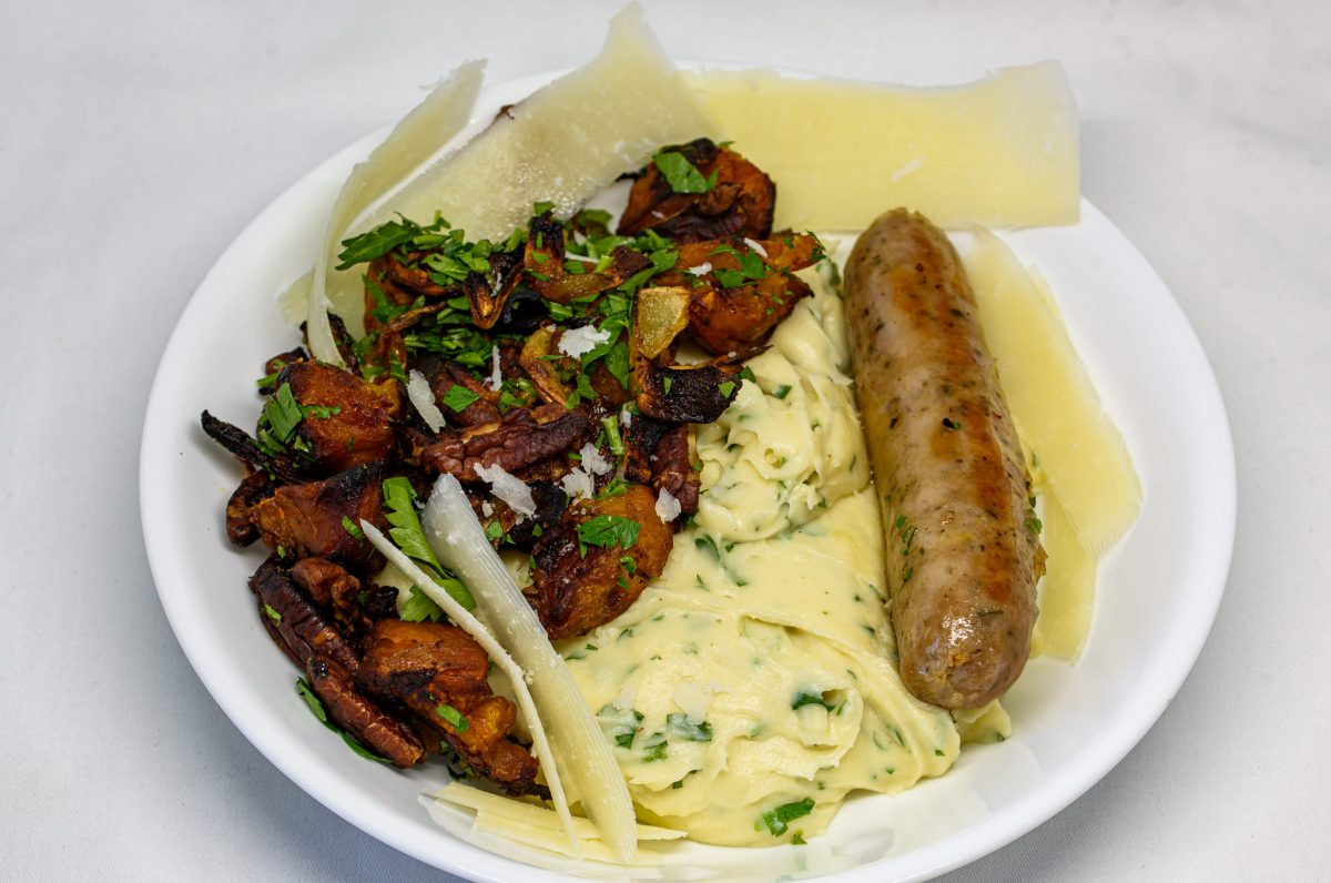 Cheesy herb-infused béchamel sauce with leftover crunchy pecan roast pumpkin and pork sausage