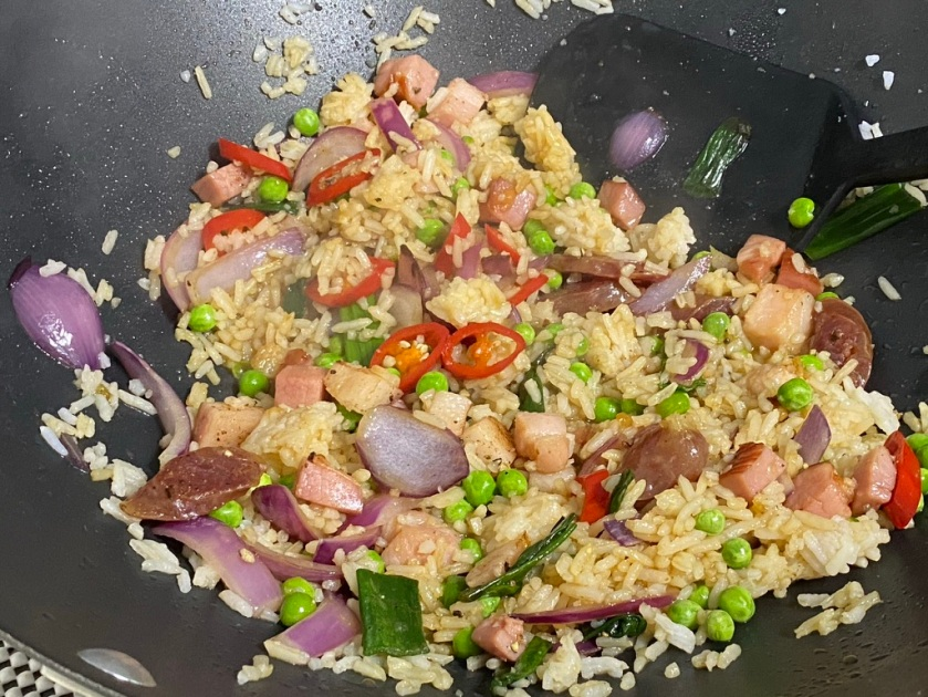 Cooking fried rice in a wok