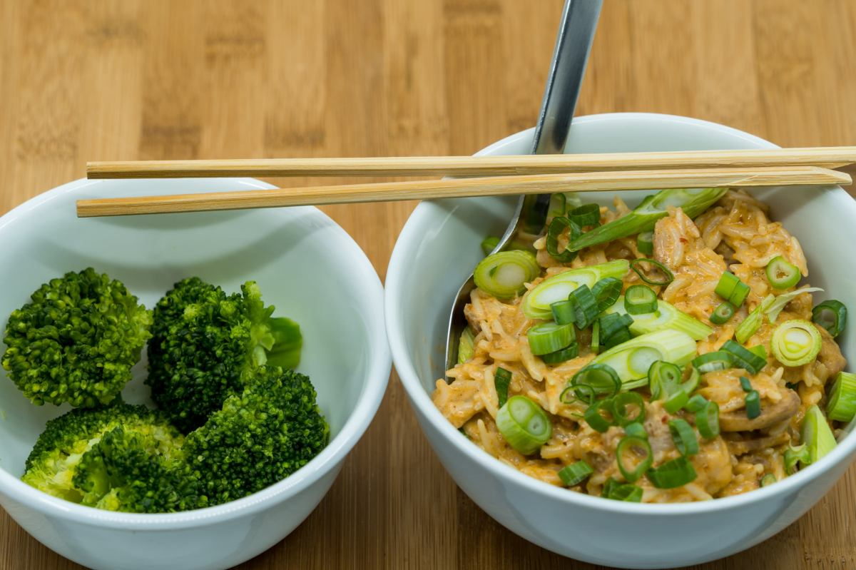Laksa-flavoured leftover pork knuckle meat with coconut creamed rice and a side ofbroccoli
