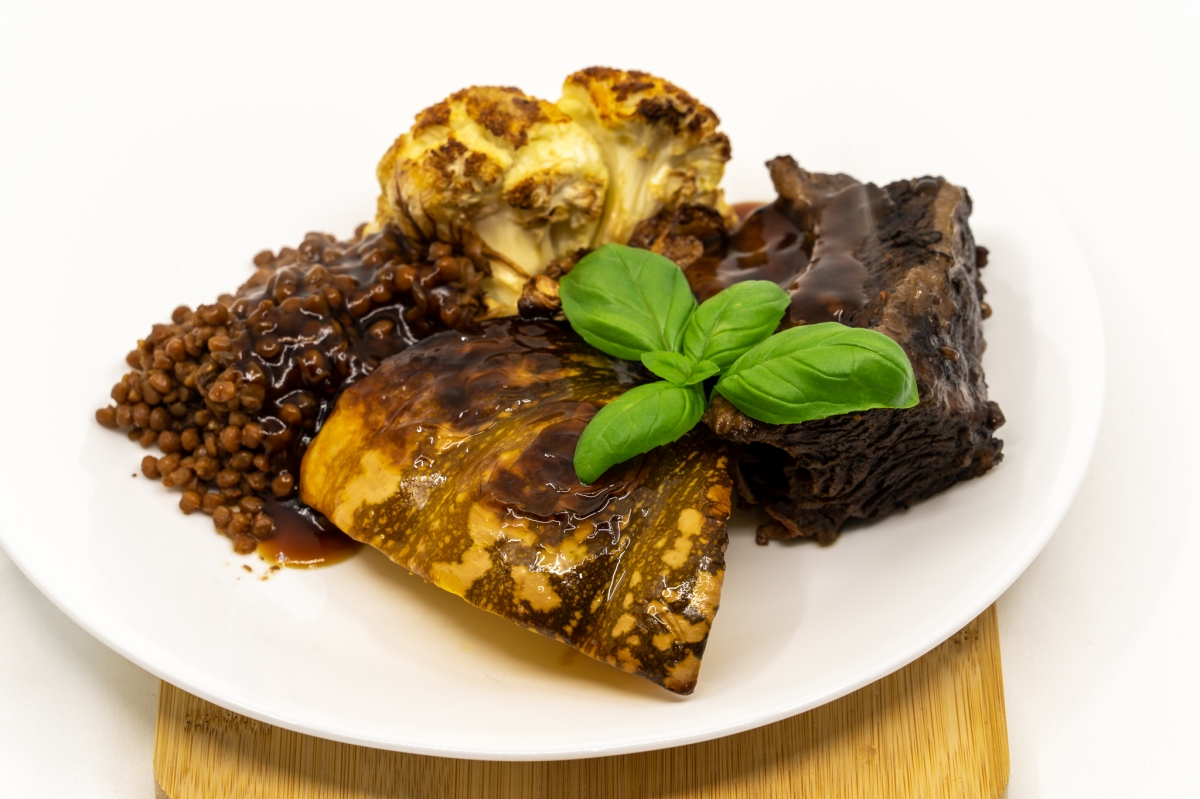 Beef short rib fingers and lentils with roast Tabasco flavoured pumpkin and cauliflower, smothered withgravy